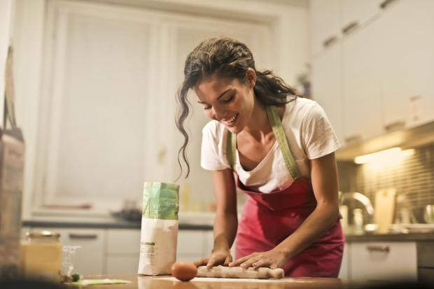 happy-woman-with-rolling-pin-cooking-at-home-3769999