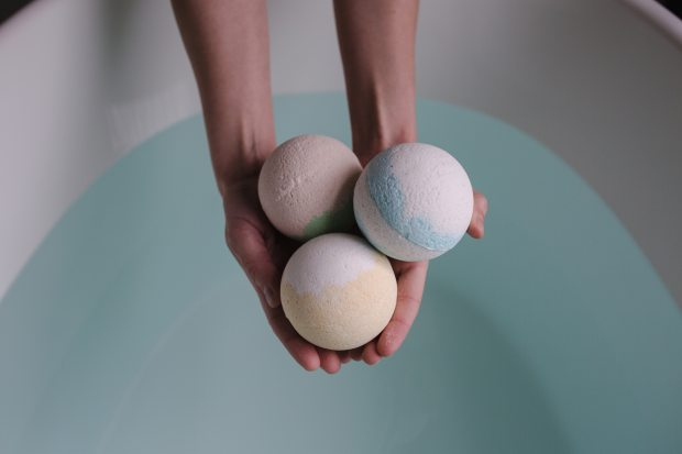 person-holding-three-bath-balls-374039