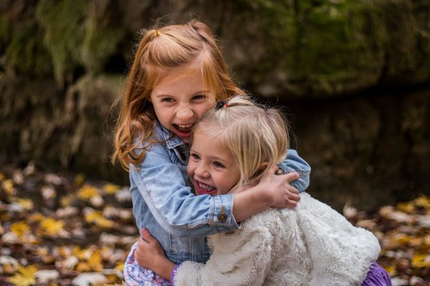 2-girls-hugging-each-other-outdoor-during-daytime-225017